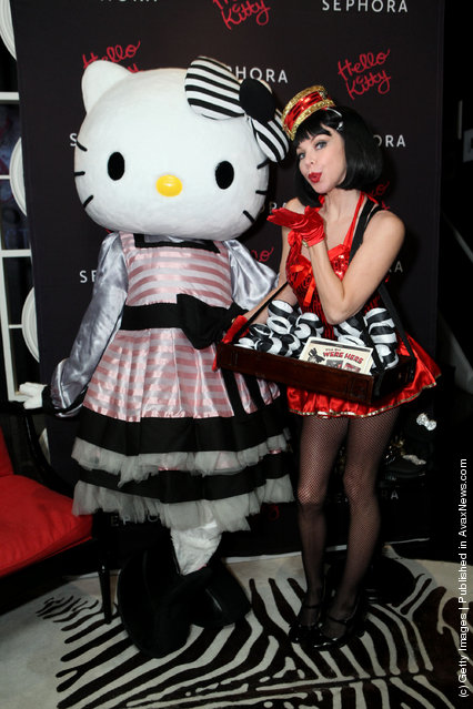 Hello Kitty and Jen Lyons of Mrs. Bella's Dolls attend The First Ever Hello Kitty Beauty Hotel Suite