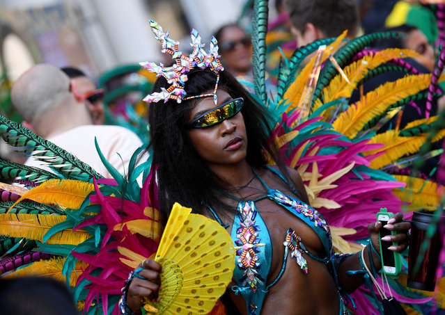 Revellers take part in the Notting Hill Carnival in London, Britain on August 26, 2019. (Photo by Toby Melville/Reuters)