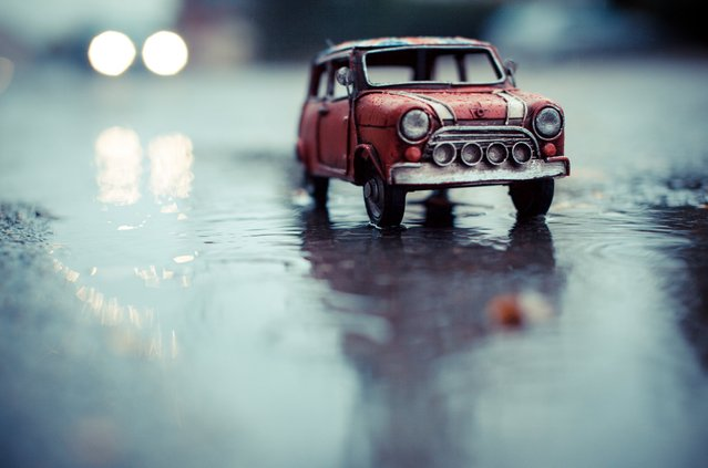"""Driving in the Rain"", Red Union Jack Mini Cooper, Solothurn, Switzerland, November 2012. (Photo by Kim Leuenberger)"