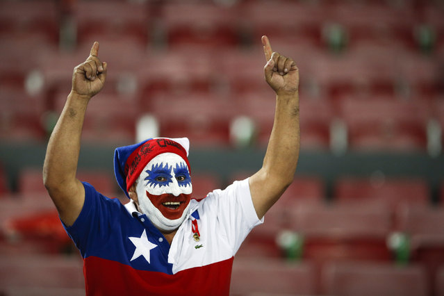 A Chile's fan poses during a Copa America semifinal soccer match between Chile and Peru at the National Stadium in Santiago, Chile, Monday, June 29, 2015. (Photo by Andre Penner/AP Photo)