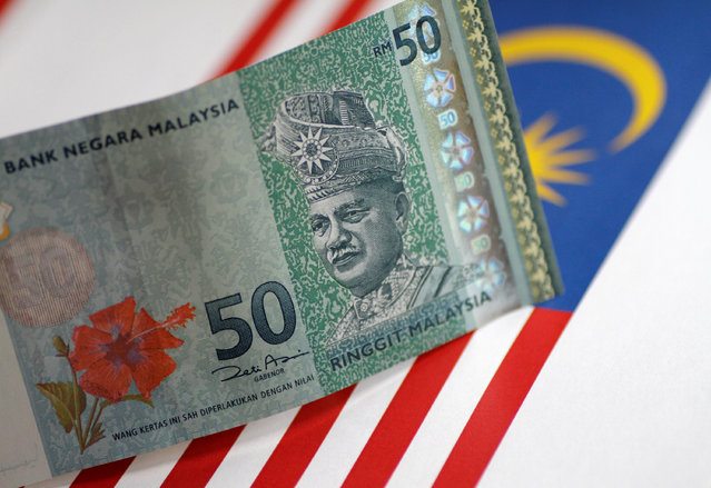 A Malaysia Ringgit note is seen in this illustration photo June 1, 2017. (Photo by Thomas White/Reuters)
