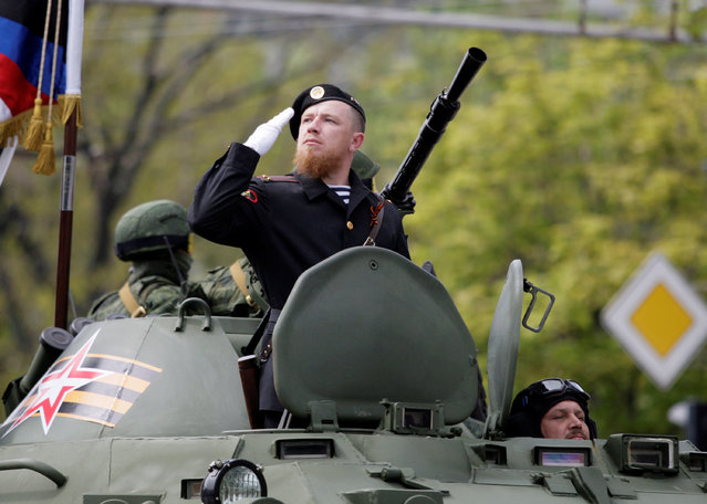 """Former pro-Russian separatist Arsene Pavlov, call sign """"Motorola"""", sits atop of an armoured personnel carrier during the Victory Day parade, marking the 71st anniversary of the victory over Nazi Germany in World War Two, in Donetsk, Ukraine, May 9, 2016. (Photo by Alexander Ermochenko/Reuters)"""
