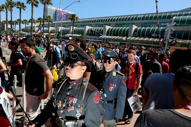 Cosplay enthusiasts walk outside the Convention Center during the 2015 Comic-Con International in San Diego, California July 10, 2015. (Photo by Sandy Huffaker/Reuters)