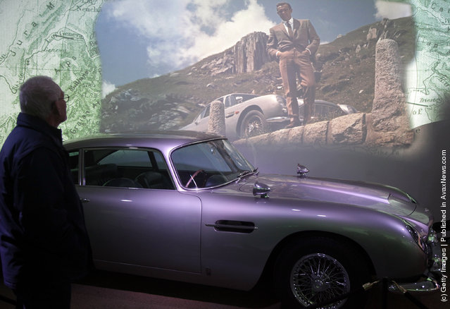 A musuem visitor looks at the Aston Martin DB5 used in the James Bond film Goldfinger and currently being displayed at the Bond In Motion exhibition