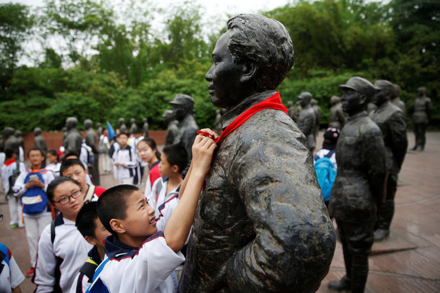 A student puts a red scarf on a statue of late Chinese Chairman Mao Zedong in the Chinese Heroes Statues Plaza, which displays war heroes of the War of Resistance against Japan, at Jianchuan Museum Cluster in Anren, Sichuan Province, China, May 13, 2016. (Photo by Kim Kyung-Hoon/Reuters)