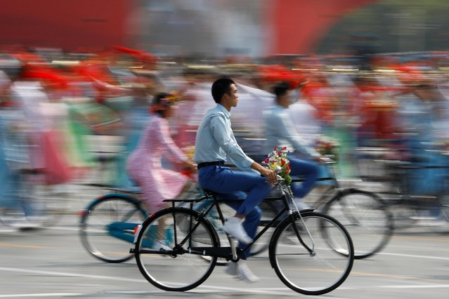 Performers ride bicycles during a parade marking the 70th founding anniversary of the People's Republic of China, on its National Day in Beijing, October 1, 2019. (Photo by Thomas Peter/Reuters)