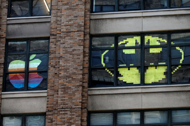 "Images created with Post-it notes are seen in the windows of offices at 75 Varick Street in lower Manhattan, New York, U.S., May 18, 2016, where advertising agencies and other companies have started what is being called a ""Post-it note art war"" with employees creating colorful images in their windows with Post-it notes. (Photo by Mike Segar/Reuters)"
