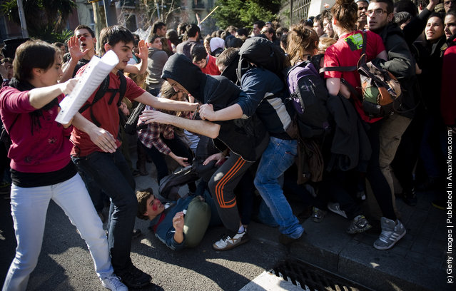 Riot Police clash with student demonstrators during a demonstration on February 2012 in Barcelona
