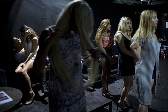 In this Tuesday, May 24, 2016 photo, contestants in the first Miss Trans Israel beauty pageant practice the walk on the stage during rehearsal in Tel Aviv, Israel. (Photo by Oded Balilty/AP Photo)