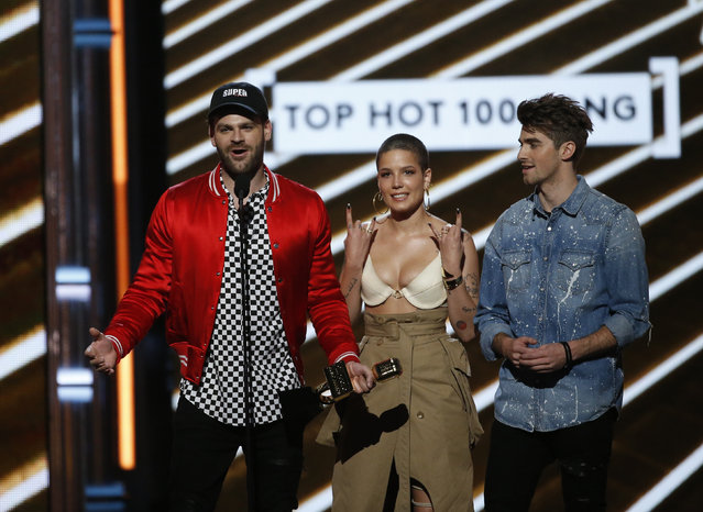 """Musicians Alex Pall (L) of The Chainsmokers, Halsey (C), and Andrew Taggart of The Chainsmokers accept the award for Top Hot 100 Song """"Closer"""" during the 2017 Billboard Music Awards at T-Mobile Arena on May 21, 2017 in Las Vegas, Nevada. (Photo by Mario Anzuoni/Reuters)"""