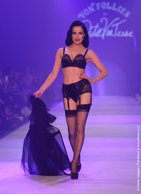 Dita Von Teese showcases designs by Von Folies by Dita Von Teese on the runway during L'Oreal Melbourne Fashion Festival