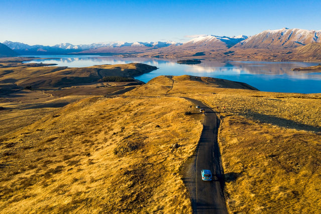 Dutchman Wiebe Wakker drives his electric vehicle, the Blue Bandit, along Lake Tekapo, New Zealand in this undated handout photo released July 19, 2019. (Photo by Wiebe Wakker/Handout via Reuters)