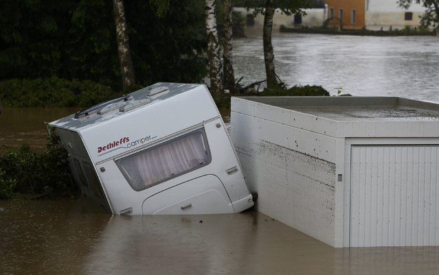 A caravan stands in water in the flooded Bavarian village of Triftern east of Munich, Germany, June 1, 2016. (Photo by Michaela Rehle/Reuters)