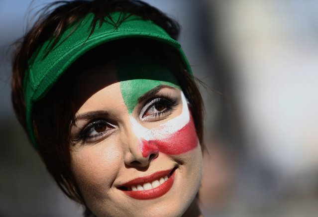 An Iranian fan cheers outside Baixada Arena in Curitiba on June 16, 2014, before the 2014 FIFA World Cup Group F football match between Iran and Nigeria. (Photo by Behrouz Mehri/AFP Photo)