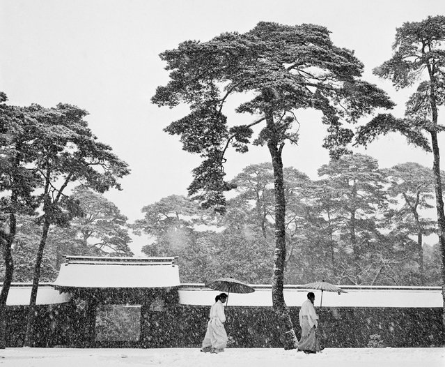 "Tokyo, Japan, 1951. Courtyard of the Meiji shrine. Rosellina, Werner Bischof's wife, wrote in her diary: ""It is snowing today – Tokyo is enchanted – Werner and I visited the Meiji shrine in Tokyo. The mood is magical, the snowfall swallows the noise of the city. Everything appears just in black and white. Suddenly Werner runs away with his camera. I stop, terrified. What happened? He comes back after a little bit. Still out of breath but overjoyed he admits: I just took THE picture of Japan!"". (Photo by Werner Bischof/Magnum Photos)"