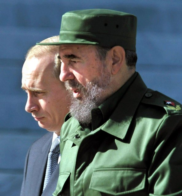 Cuban President Fidel Castro (R) stands with Russian President Vladimir Putin (L) 14 December 2000 in Havana. The two leaders denounced US world domination during an historic summit, pledging to rebuild their Cold War-era ties. (Photo by Sergei Chirikov/AFP Photo)