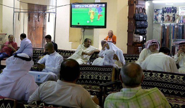 Kuwaitis watch the UEFA Euro 2016 opening football match between France and Romania at a traditional coffee shop in downtown Kuwait City on June 10, 2016. (Photo by Yasser Al-Zayyat/AFP Photo)