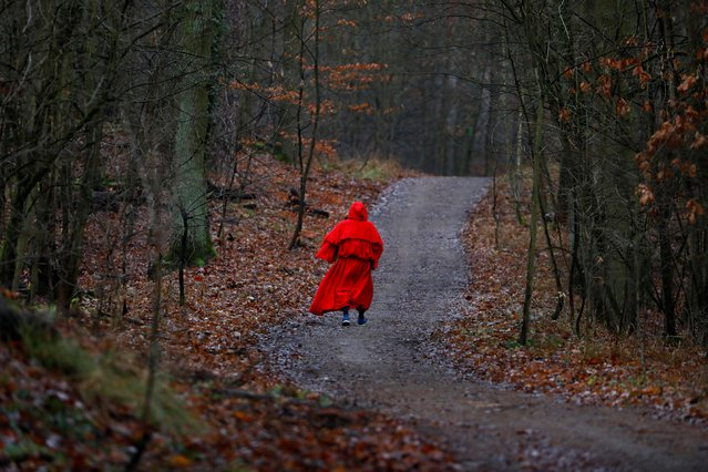 "A runner dressed as Santa Claus walks through the forest while joining the annual ""Roast Goose Digestion Run"" aiming to burn the calories after holiday celebrations in Berlin, Germany December 26, 2019. (Photo by Michele Tantussi/Reuters)"