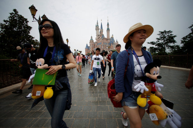 People walk at Shanghai Disney Resort during a three-day Grand Opening event in Shanghai, China, June 15, 2016. (Photo by Aly Song/Reuters)
