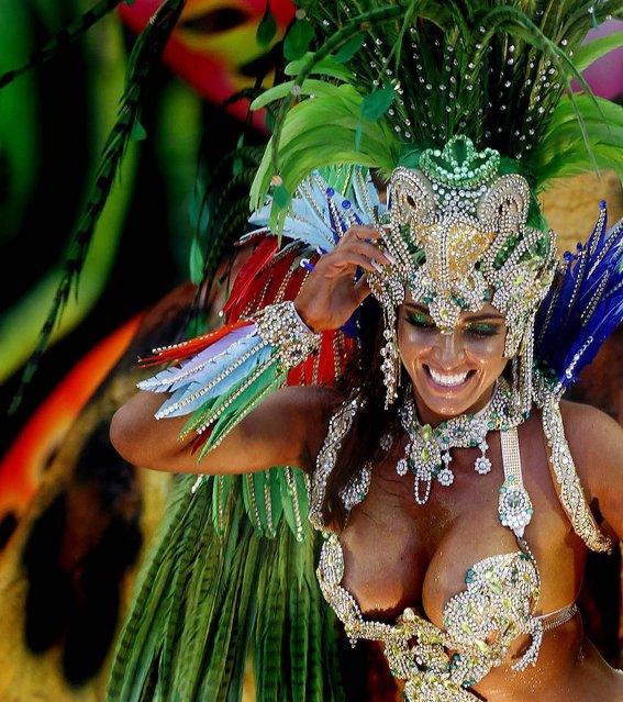 A Beija Flor samba school dancer performs at the Sambadrome in Rio de Janeiro