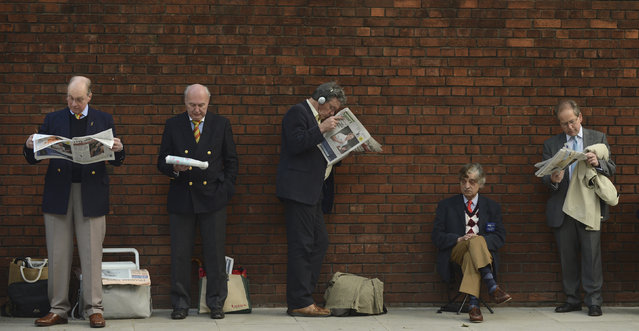 Marylebone Cricket Club (MCC) members read newspapers as they wait in a queue outside the ground before the cricket test match between England and the West Indies at Lord's cricket ground in London May 18, 2012. (Photo by Philip Brown/Reuters)