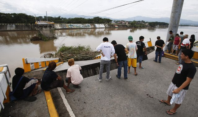 Residents gather near a bridge destroyed during the onslaught of Typhoon Rammasun, (locally named Glenda) in Batangas city south of Manila, July 17, 2014. (Photo by Erik De Castro/Reuters)