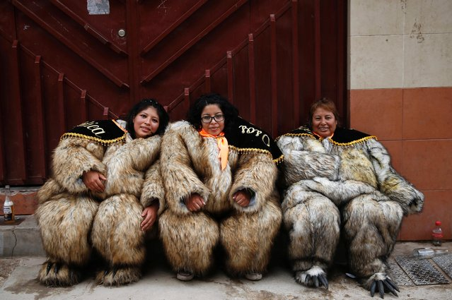 Dancers dressed as bears rest after attending a mass at Socavon church after taking part in the carnival parade in Oruro, Bolivia, February 22, 2020. (Photo by David Mercado/Reuters)
