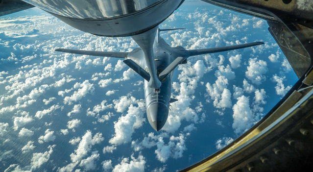 One of two U.S. Air Force B-1B Lancer bombers receives fuel from a KC-135 Stratotanker while flying a 10-hour mission from Andersen Air Force Base, Guam, into Japanese airspace and over the Korean Peninsula, July 30, 2017. (Photo by Staff Sgt. Joshua Smoot/Reuters/U.S. Air Force)