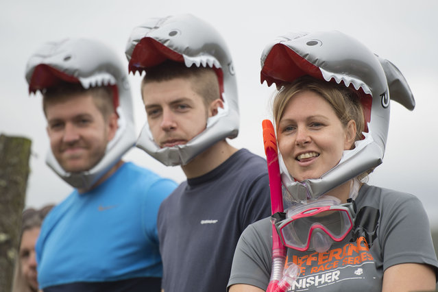 Spectators look on during the World Bog Snorkelling Championships 2017 on August 27, 2017 in Llanwrtyd Wells, Wales. (Photo by Matthew Horwood/Getty Images)