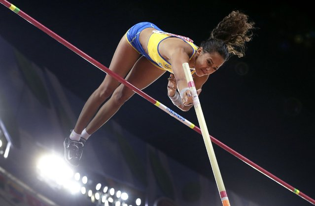 Sweden's Angelica Bengtsson clears the bar during the women's pole vault final at the World Athletics Championships at the Bird's Nest stadium in Beijing, Wednesday, August 26, 2015. (Photo by Andy Wong/AP Photo)