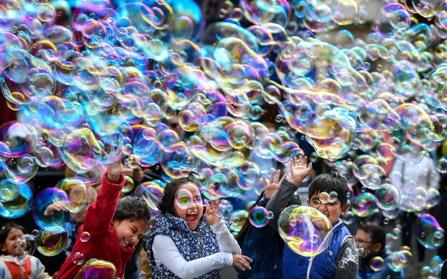 A street performer on the Royal Mile entertains members of the public with a mass of bubbles on May 27, 2019 in Edinburgh, Scotland. (Photo by Jeff J Mitchell/Getty Images)