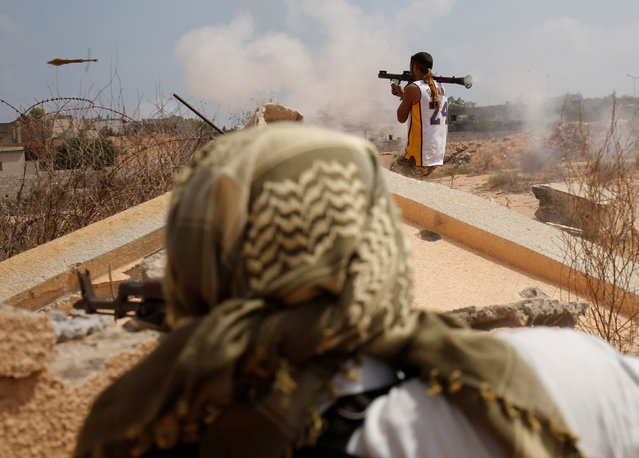 Libyan forces allied with the U.N.-backed government fire weapons during a battle with Islamic State fighters in Sirte, Libya, July 15, 2016. (Photo by Goran Tomasevic/Reuters)