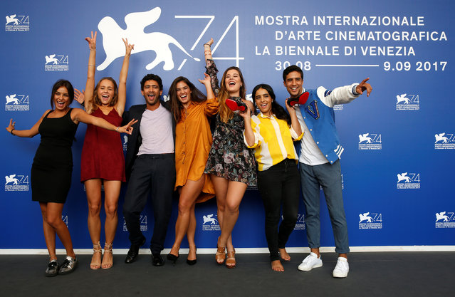 """(L to R) Actors Melinda Elastfour, Lou Luttiau, Shain Boumediene, Ophelie Bau, Alexia Chardard, Hafsia Herzi and Salim Kechiouche pose during the photocall for the movie """"Mektoub, My Love: Canto Uno"""" at the 74th Venice Film Festival in Venice, Italy on September 7, 2017. (Photo by Alessandro Bianchi/Reuters)"""