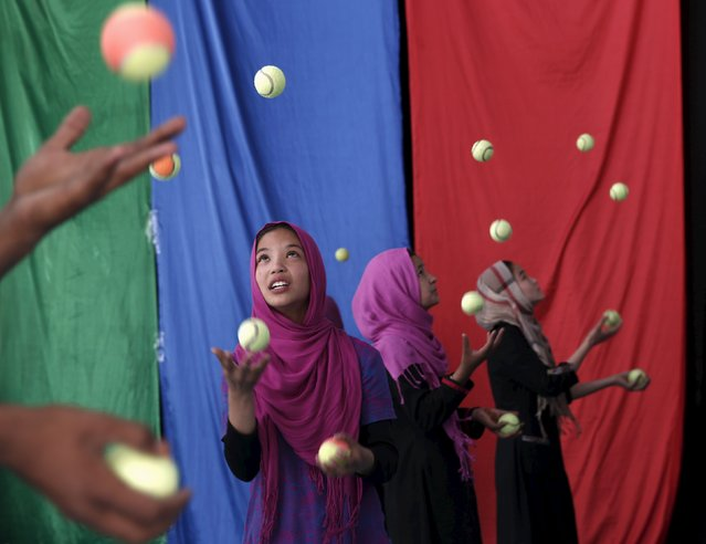 Girls, who are part of Afghan Mobile Mini Circus for Children (MMCC), participate in a juggling competition in Kabul, Afghanistan August 12, 2015. (Photo by Ahmad Masood/Reuters)