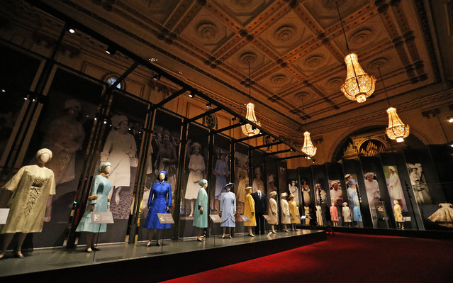 Dresses of Britain's Queen  Elizabeth are on display at an exhibition at Buckingham Palace in London, Thursday, July 21, 2016. (Photo by Frank Augstein/AP Photo)