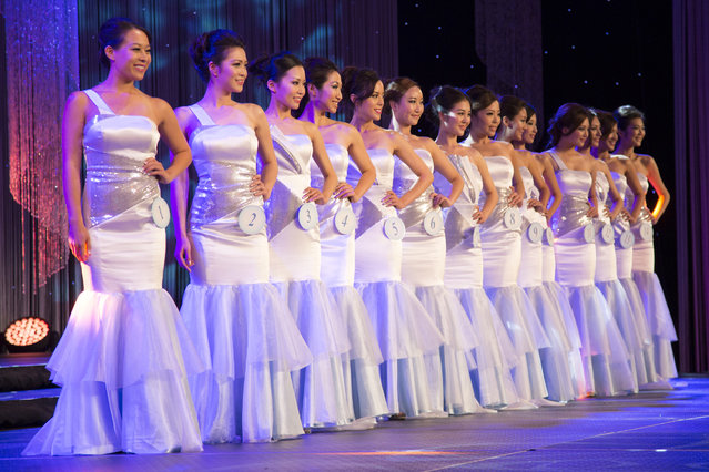 "Contestants for Miss NY Chinese Beauty Pageant 2014 gather on stage for the announcement of the overall winner along with other prizes for congeniality, fitness and photogenic appeal. ""I remember watching Hong Kong's beauty pageant competitions every year growing up and I have always imagined myself as one of the girls on stage"", said Lili Wat. ""Now as one of the top 14 contestants, my dream have finally come true"". (Photo and caption by John Brecher/Sahra Vang Nguyen/NBC News)"