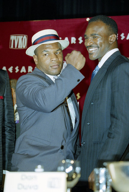 Mike Tyson, left, poses with World Heavyweight boxing champ Evander Holyfield during a news conference in New York, September 4, 1991, to discuss their scheduled match November 8 in Las Vegas at Caesar's Palace. (Photo by Mike Albans/AP Photo)