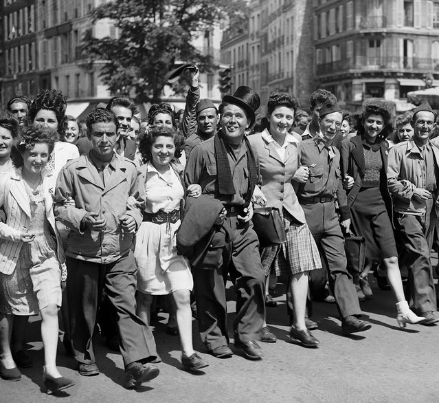 Picture taken on May 8, 1945 of civilians, partisans and soldiers joyfully parading in the streets of Paris, the V-E Day, the day of hostilities' end in Europe, during the second World war. (Photo by AFP Photo)