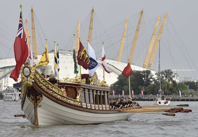 Crew members row the The Queen's Barge Gloriana at the head of a flotilla, near the 02 Arena in London September 7, 2014. (Photo by Toby Melville/Reuters)