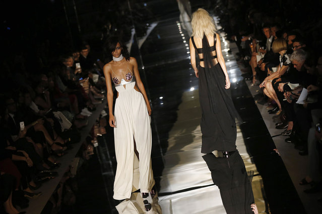 Models present creations from the Tom Ford Spring/Summer 2015 collection during London Fashion Week  September 15, 2014. (Photo by Suzanne Plunkett/Reuters)