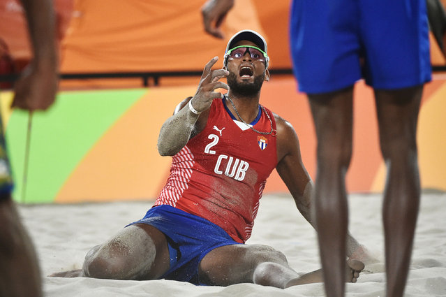 Cuba's Sergio Reynaldo Gonzalez Bayard reacts during the men's beach volleyball qualifying match between Brazil and Cuba at the Beach Volley Arena in Rio de Janeiro on August 7, 2016, for the Rio 2016 Olympic Games. (Photo by Yasuyoshi Chiba/AFP Photo)