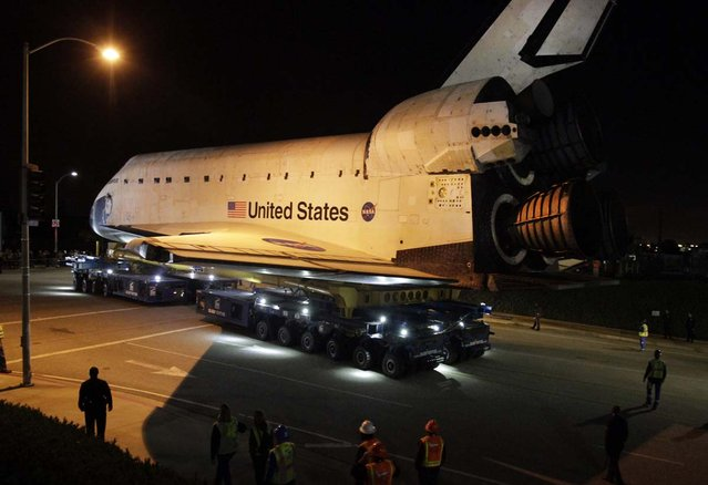 The space shuttle Endeavour leaves Los Angeles International Airport onto the streets of the Westchester neighborhood in the early hours of  in Los Angeles, California. The space shuttle will make a two-day trek across Los Angeles and Inglewood to the California Science Center, where it will be on permanent display.  (Photo by Lawrence K. Ho)