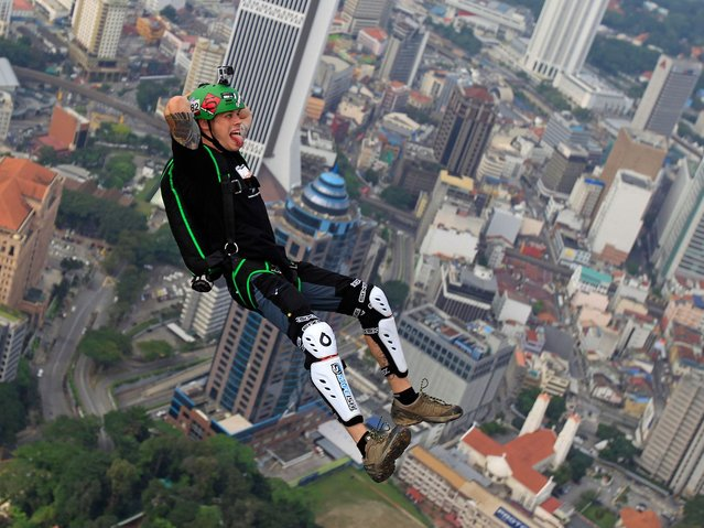 Applicants needed to have made at least 120 BASE jumps, including 20 over the past year, to play a part in the four-day event. (Photo by Lai Seng Sin/AP Photo)