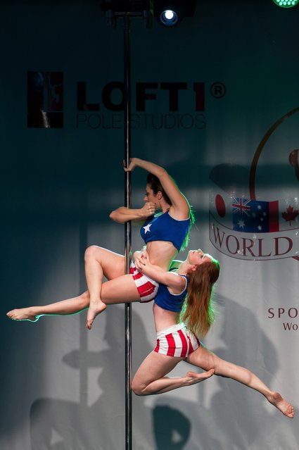 Competitors participate at the World Pole Dancing Championship 2012 held at the Volkshaus on November 10, 2012 in Zurich, Switzerland. The public's perception of pole dancing has recently changed to become a popular sport combining physical strength, technique and choreography.  (Photo by Harold Cunningham)