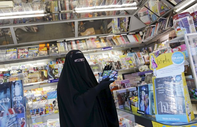 Gisele Marie, a Muslim woman and professional heavy metal musician, holds music CDs in a shop after a rehearsal at her house, in Sao Paulo September 15, 2015. (Photo by Nacho Doce/Reuters)