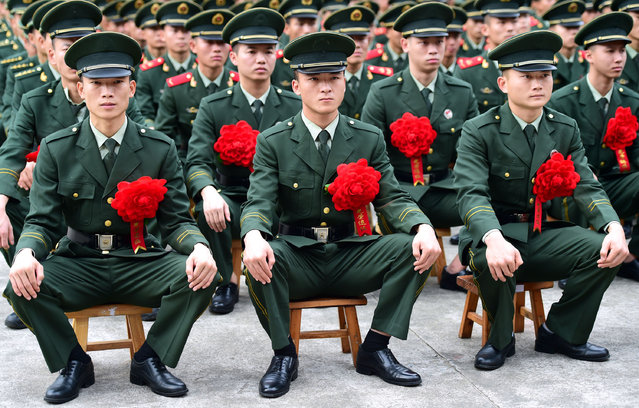 Armed soldiers attend military discharge ceremony on November 30, 2017 in Shenzhen, Guangdong Province of China. Over 100 veterans discharged from military service bid farewell to their comrades and left the army. (Photo by VCG/VCG via Getty Images)