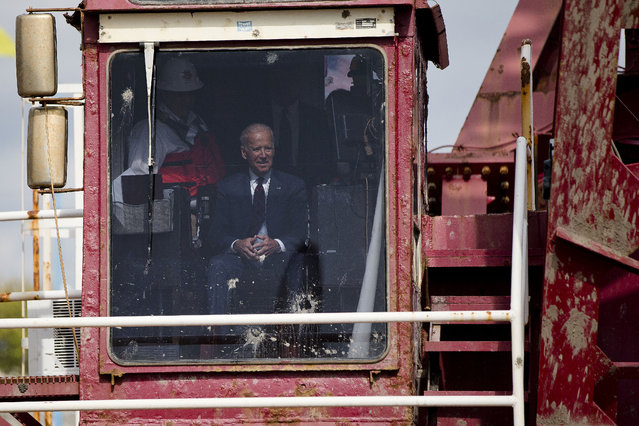 Vice President Joe Biden tours a dredging barge, Thursday, October 16, 2014, at Penn's Landing along the Delaware River in Philadelphia.  Biden discussed the importance of investing in the nation's infrastructure during his visit to the waterfront. (Photo by Matt Rourke/AP Photo)