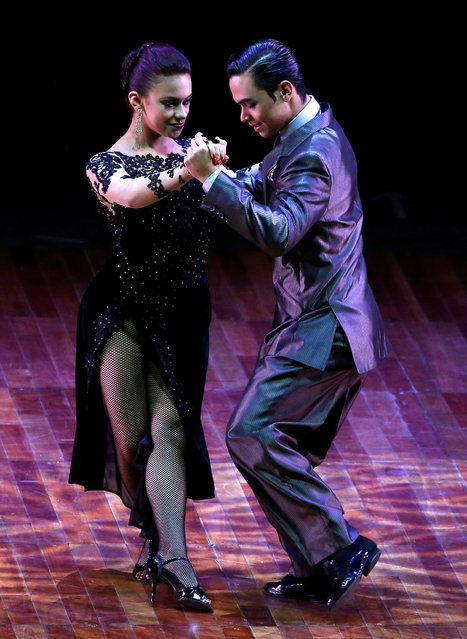 Juan David Vargas Landinez and Paulina Mejia Gallego, from Colombia, perform their routine at the Stage style Tango World Championship, in Buenos Aires, Argentina, August 31, 2016. (Photo by Enrique Marcarian/Reuters)