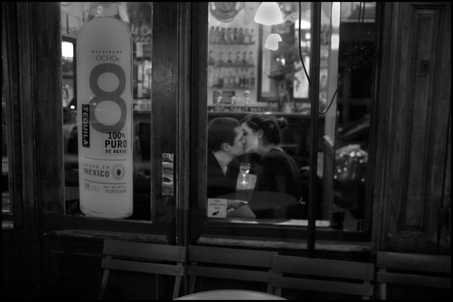 Cafe passion. On my way to dinner tonight, I noticed this moment of a passionate cafe kiss as I walked by the Perla Bar. (Photo and comment by Peter Turnley)