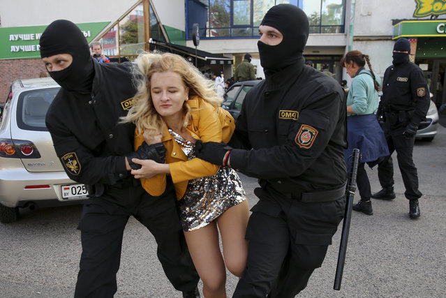 Police officers detain a woman during an opposition rally to protest the official presidential election results in Minsk, Belarus, Saturday, September 19, 2020. (Photo by TUT.by via AP Photo)